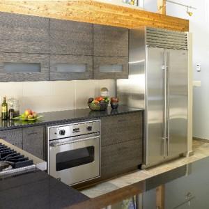 Freestanding Subzero stainless fridge with sidepanel