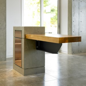 Concrete bar, copper cabinet door, steel I-Beam and Birch Counter