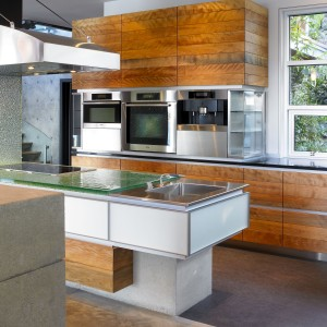 Appliance tower with frameless glass corner endcabinet