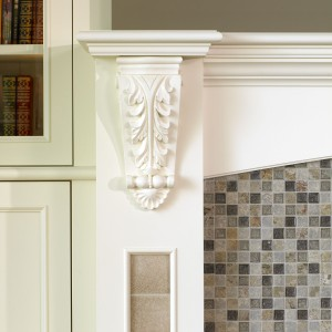 The glass/stone mosaic tile on this fireplace reflects the natural hues of the cliff upon the house is built