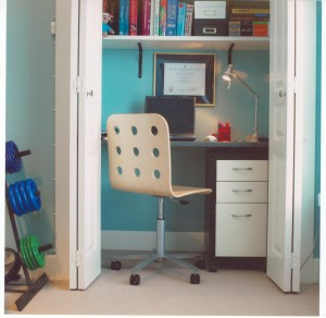 Intense aqua colour gives energy to this office-in-a-closet
