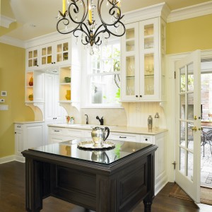 A beautiful yellow adds some mediterranean warmth to this elegant kitchen